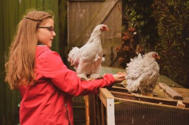 Girl with Pet Chickens